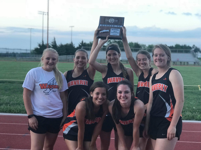 Girls track team holding 2nd place plaque
