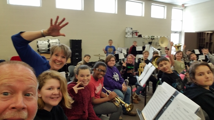 Laura Holiday, 2nd year band clinician, poses with the trumpet section for a selfie.