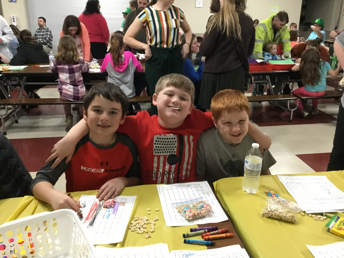 2nd graders enjoying math night .