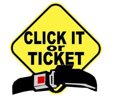 "Yellow warning sign with ""Click it or Ticket"" seatbelt over the lower portion of sigh"