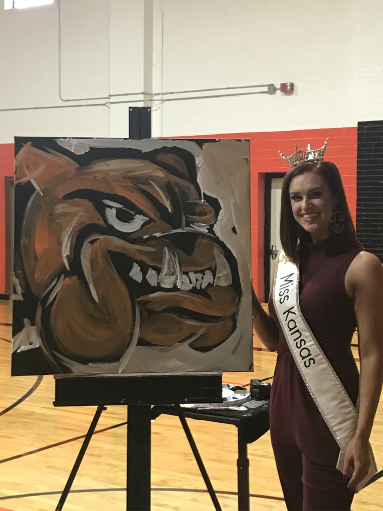 Miss Kansas, Annika Wooton, with the Bulldog she painted for WHS.