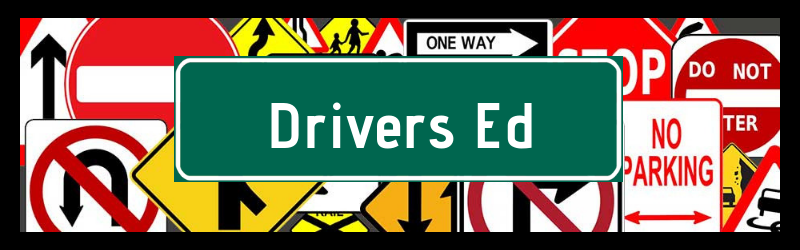 Drivers Ed words with traffic signs in the background