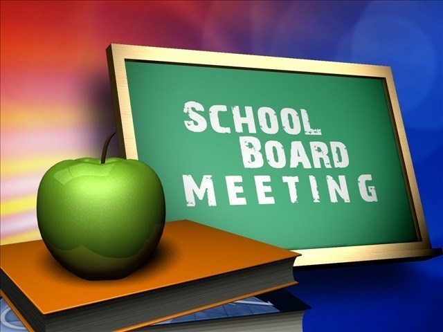 School Board meeting written on chalkboard with an apple and book to the side