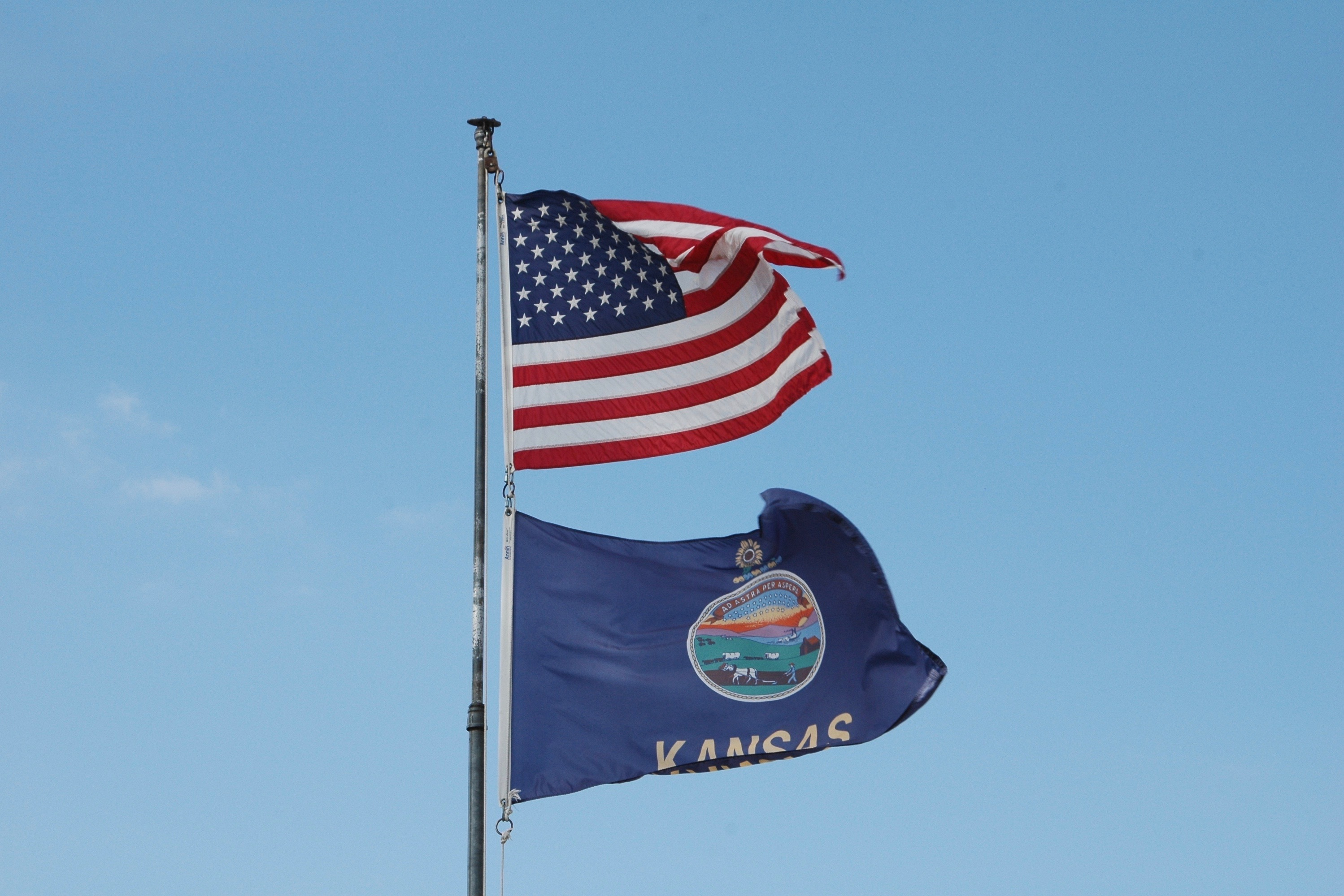 U.S. and Kansas Flag waving in the wind